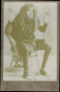 "One of many ""wild men"" who appeared in circuses and freak shows in the late nineteenth century.  Notice the manacles."